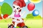 Bambina sul triciclo